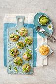 Blinis with Prague ham, green asparagus and avocado sour cream