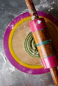 Raw pastry for Indian spinach and cashew nut paratha being rolled out