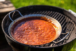 BBQ sauce on a barbecue