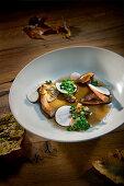 Natural cuisine: wild mushrooms in a clear broth