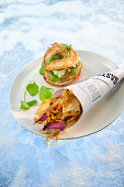 Natural cuisine: a bagel with quail served with fried root vegetables crisps