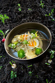 Natural cuisine: hops shoots with soft-boiled eggs and beer foam sauce