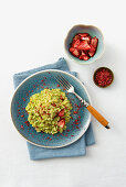 Green asparagus risotto with strawberry powder