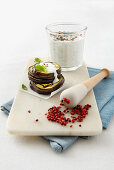 Yoghurt sauce with pink pepper and peppermint for grilled aubergines