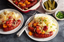 Sausage baked with onion and cherry tomatoes, potatoes puree