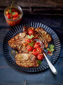 Minute steaks with preserved tomatoes