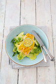 Salmon filler with a honey-mustard coating and avocado and cucumber salad