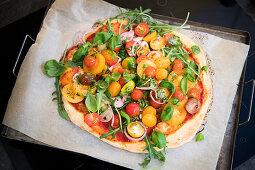 Pizza with tomatoe salad with truffle salami