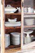 Stacked china crockery in display case