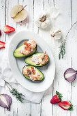 Stuffed avocados with garlic prawns