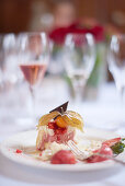 Dessert plate with raspberry mousse and rose champagne