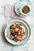 Fusilloni with aubergines, tomato sauce, tapenade and stracciatella
