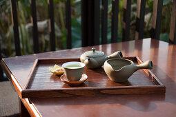 Green tea served near a lotus pond