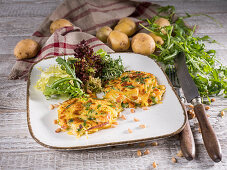 Pumpkin and zucchini patties with pine nuts and lettuce