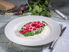 Beetroot gnocchi with creamed spinach, parmesan cheese and cream sauce