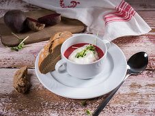 Beetroot soup with white pepper foam, cress and rye bread