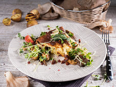 Spanish tortilla with cress, tomato, oyster mushrooms and grilled potatoes