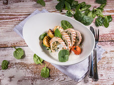 Turkey roulade with baby spinach, cherry tomato and grilled potatoes
