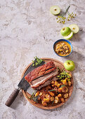 Whisky, sage and maple pork belly with buttery caramelised apples