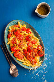 Penne with roasted tomatoes, pecorino and garlic hemp-seed oil