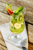 Fruit salad with banana, kiwi, fig and mint