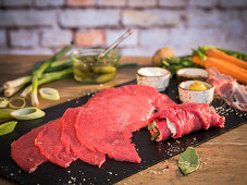 Raw beef roulades with ingredients