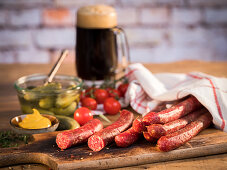 Beef pork sausages, mustard, gherkins, cherry tomatoes and dark country beer