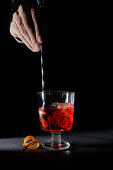 Negroni cocktail stirred with a bar stool
