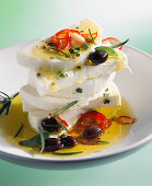 Marinated feta cheese with olive oil, chilli peppers, olives and rosemary