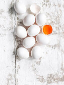 an arrangement of eggs with an egg yolk in an egg shell
