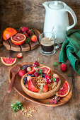 Granola with berries and blood orange