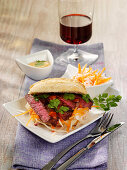Asiatic style baguette rolls with beefsteak, radish and chilli sauce