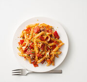 Penne pasta with a pepper and squid sauce