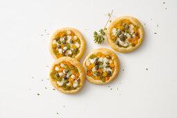 Puff pastry mini pizzas with pepper and mozzarella