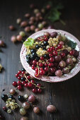 An arrangement of gooseberries and various redcurrants