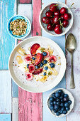 Breakfast bowl with cherry and blueberries