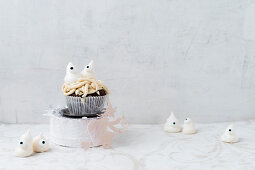 Halloween meringue ghosts on a cupcake with worms
