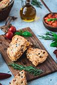 Mediterranean scones with spicy tomato spread on a wooden board