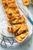 Almond frangipane tart with apricots, sliced