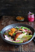 Porchetta with apricot chutney and pickled red onion