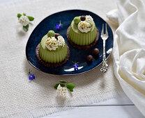 Raw vegan matcha lime tarts with chocolate and almond bases