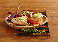 Grilled tuna fish steaks in a lemon and herb marinade with red onions and chillis
