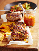 Meat patties with salsa, sweetcorn, potatoes and tortilla chips (Mexico)