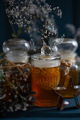 Jars of honey and honeycomb decorated with gypsophilia
