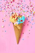 Ice cream cone with colorful ice cream, mini marshmallows, and sugar stars