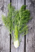 Fresh fennel on a wooden surface