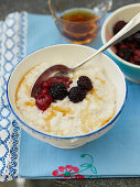 Bowls of rice pudding with berries