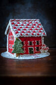 A beautifully decorated red gingerbread house