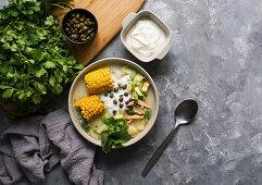 Ajiaco Colombiano - patato soup common in Colombia, Cuba and Peru, Latin America