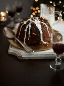 Christmas pudding with sticky fudge sauce